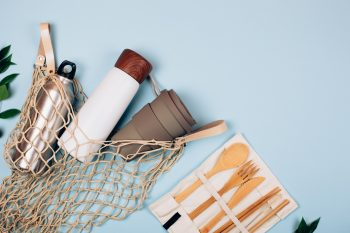 Water bottles and recyclable items to portray sustainable products
